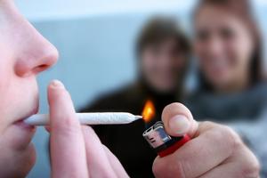 Person smoking marijuana