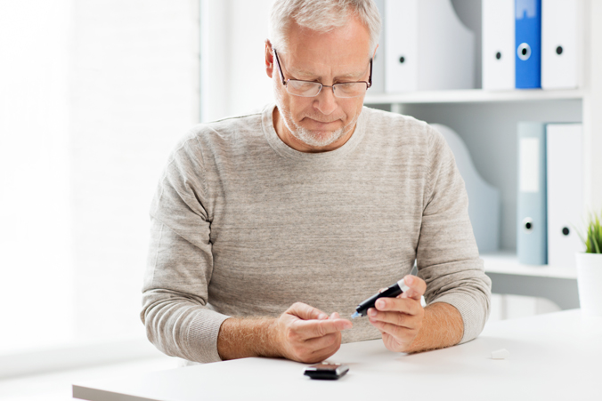 Middle Aged Man Checking Blood Sugar