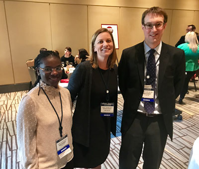 "Foluso O. ""Bisi"" Ademuyiwa, MD, MPH, MSCI; Lindsay L. Peterson, MD, MSCR; and Jeffrey P. Ward, MD, PhD, all of Washington University School of Medicine in St. Louis, catch up during the reception."