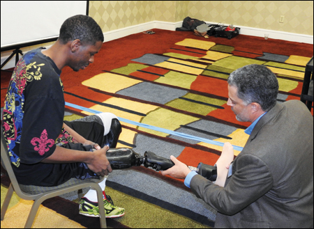 Matthew Nelson, CPO, senior clinical prosthetist, coding and reimbursement manager for Freedom Innovations, conducts a patient demonstration with Jamel Merritt.