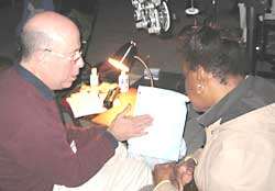 Douglas Weiss, MD explains eye examination results to a patient