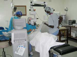 Volunteer Richard T. Kasbeer, MD, performs cataract surgery