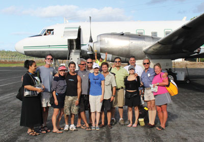 The Hawaiian Eye Foundation Tonga team from September 2009 is ready to board a 1950s era airplane to travel to the smaller islands.