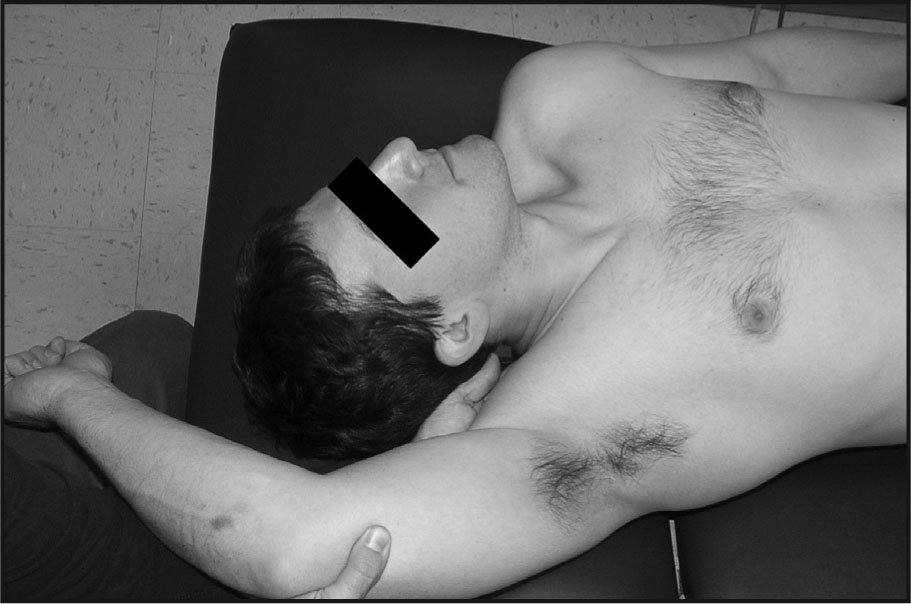The Position of the Strain Counterstrain Treatment for the Right Upper Trapezius. The Head Is Laterally Flexed to the Ipsilateral Side and Rotated Away While the Tender Point Is Palpated. The Shoulder Is Passively Moved into Flexion and Relative External Rotation According to Feedback from the Subject.