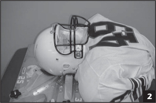 Mounting fixture used to secure helmets prior to face mask removal.