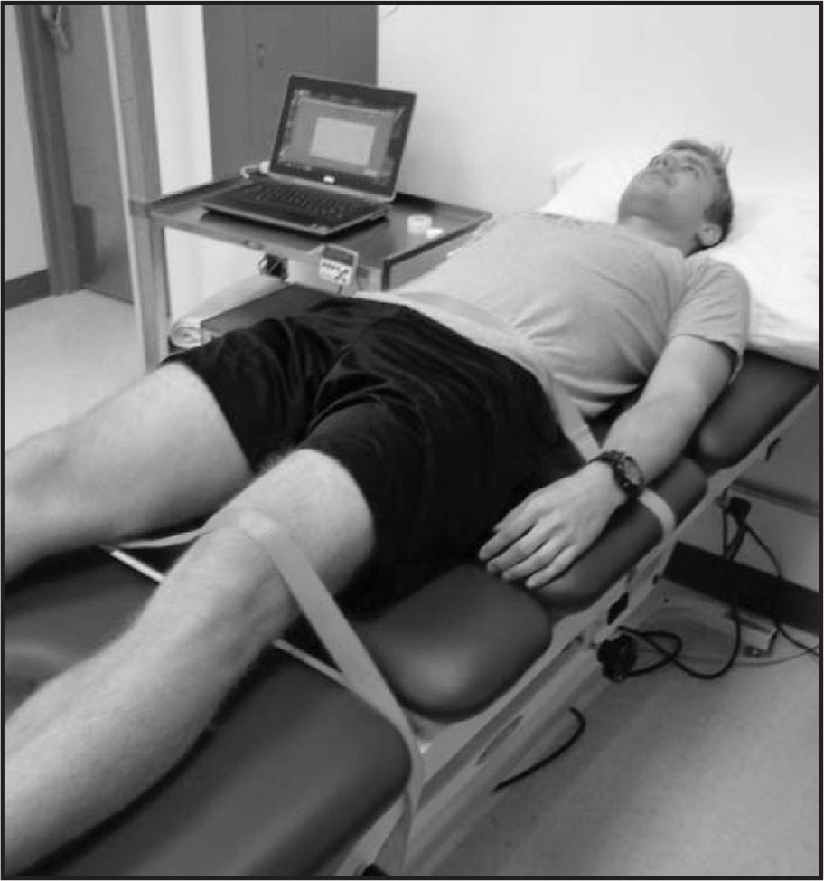 Patient positioning for static stretching of the hamstring muscle group. To minimize accessory motions a belt was applied to the patients' waist and to their non-dominant leg.