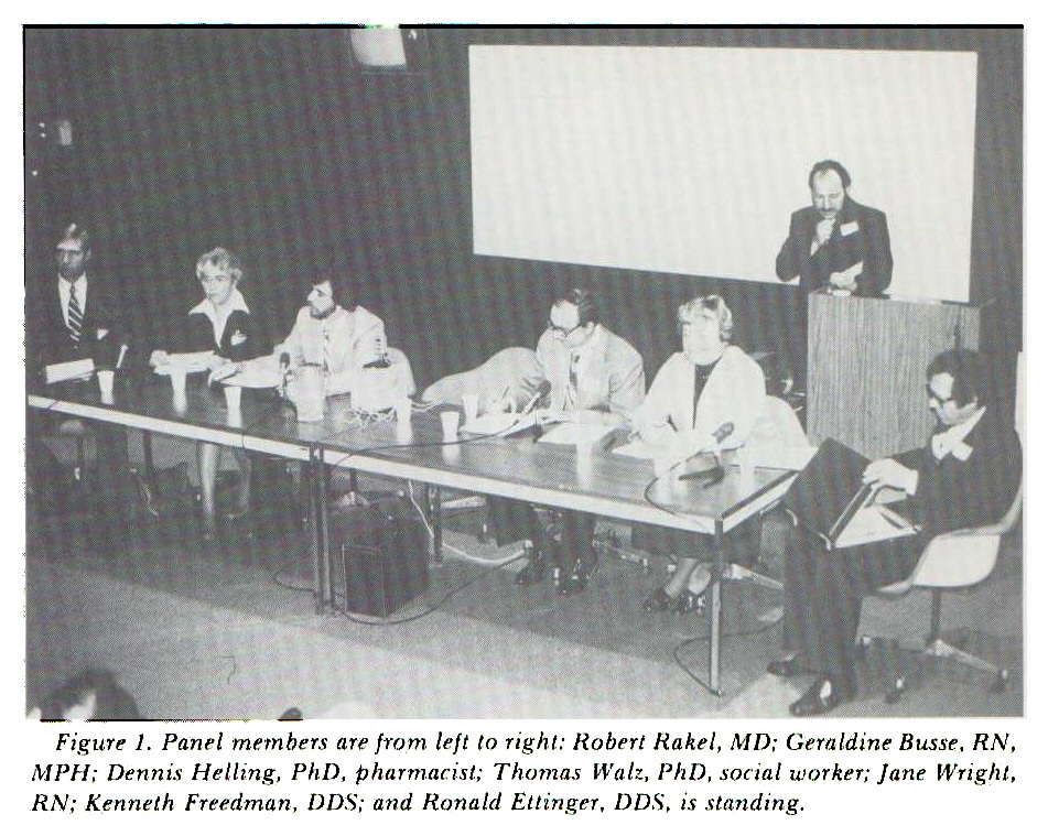 Figure 1. Panel members are from left to right: Robert Rakel, MD; Geraldine Busse, RN, MPH; Dennis Helling, PhD, pharmacist; Thomas Walz, PhD, social worker; Jane Wright, RN; Kenneth Freedman, DDS; and Ronald Ettinger, DDS, is standing.