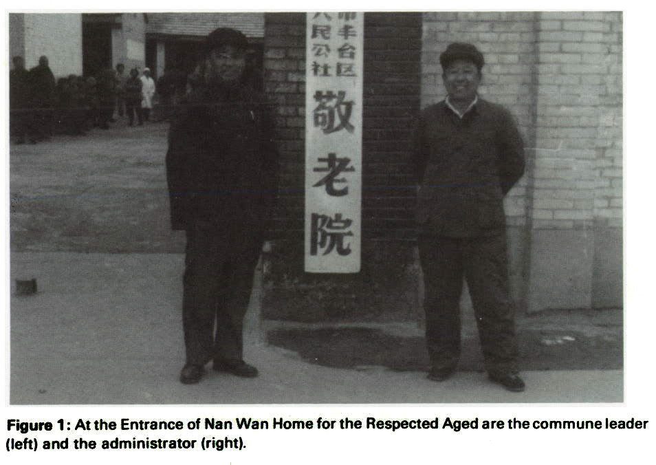 Figure 1 : At the Entrance of Nan Wan Home for the Respected Aged are the commune leader (left) and the administrator (right).