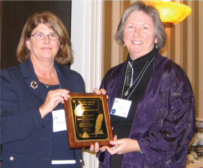 Journal of Gerontological Nursing Editor Kathleen C. Buckwalter, Rn, Phd, Faan, Presents Theresa A. Harvath, Phd, Rn, Cns, with a Plaque for the Edna Stilwell Writing Award, Which Harvath Accepted on Behalf of the Winning Article's Authors.Photo Credit: Slack Incorporated