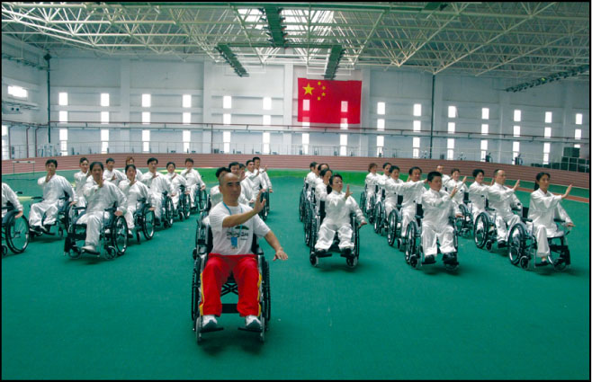 Although He Does not Use a Wheelchair for Mobility, Dr. Zibin Guo Used the Device to Demonstrate an Innovative Tai Chi Technique for a Group in China.Photo Courtesy of the University of Tennessee at Chattanooga