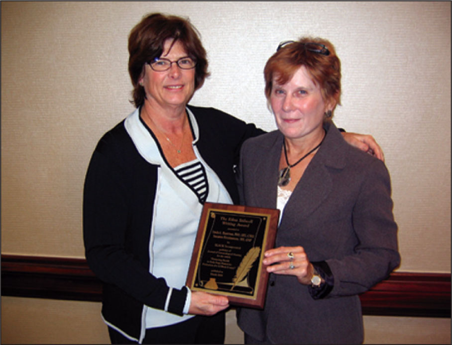 Journal of Gerontological Nursing Editor Emerita Kathleen C. Buckwalter presented Lin Buettner with the Edna Stilwell Writing Award in 2009.