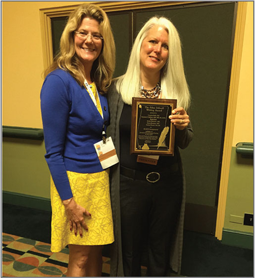 Donna M. Fick, PhD, RN, FGSA, FAAN, Editor (left), presents the Edna Stilwell Writing Award to Louanne Bakk, PhD, on behalf of Dr. Porock, during the Gerontological Society of America's annual conference in Orlando, Florida.