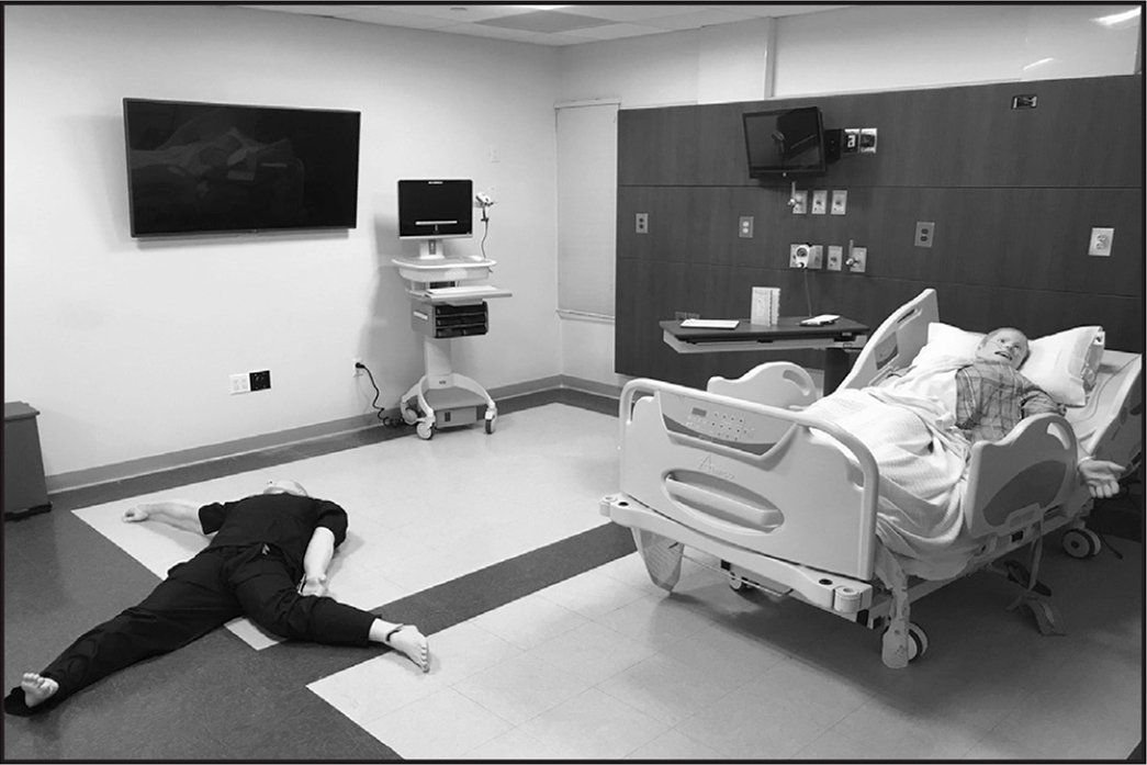 The initial room setup with a patient in bed and nurse on the ground.