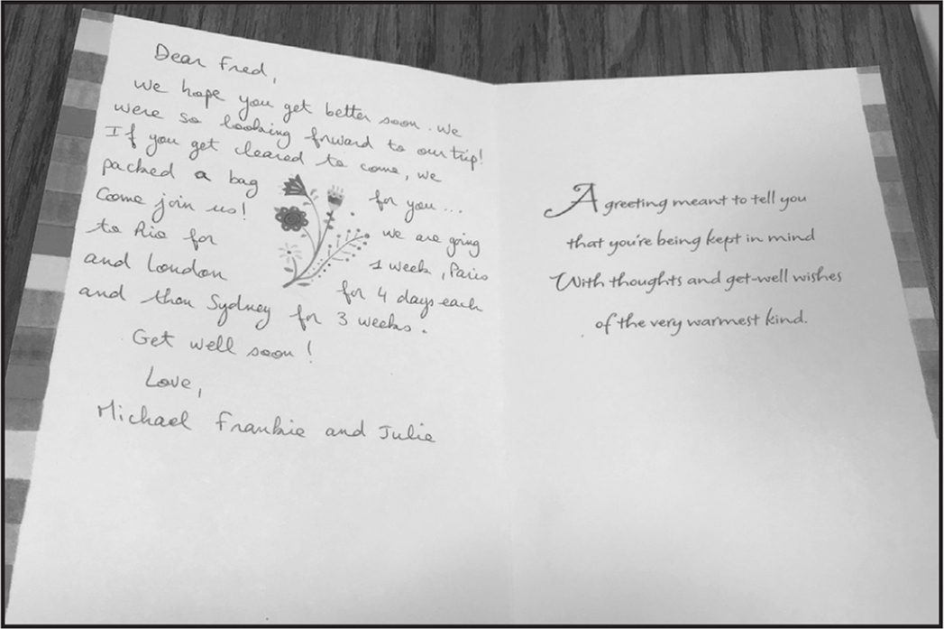 A card on the bedside table, related to the suitcase.