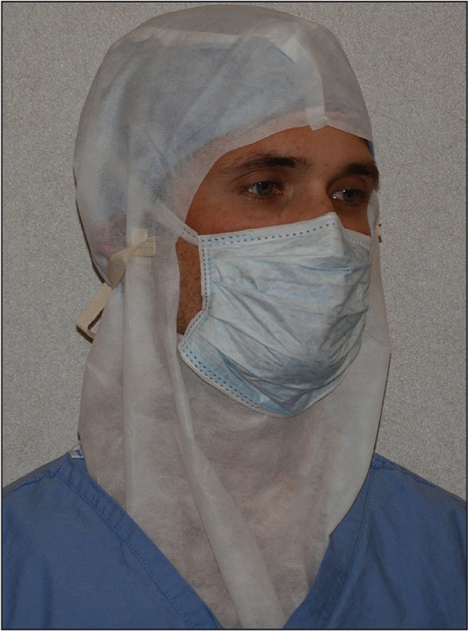 Photograph showing the surgical mask and nonsterile surgical hood used in the experimental protocol.