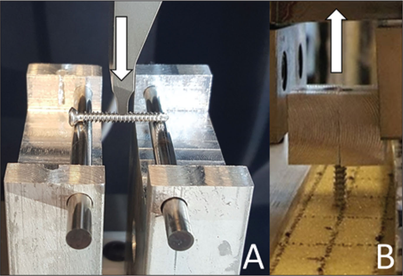 Photograph of the experimental setup used for the 3-point bending of screws. The actuator moved in the direction of the arrow at a constant rate to create a bending moment (A). Photograph of the experimental setup used for the pull-out test. Grips clamp a custom-made fixture around the neck of the screw head and pull in the direction of the arrow at a constant velocity (B). Fully threaded solid cortical screws are being tested in both photographs.