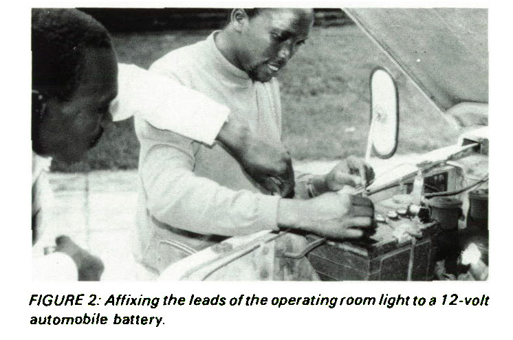 FIGURE 2: Affixing the leads of the operating room light to a 12-vo/t automobile battery.