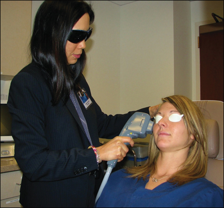 Joanne F. Shen, MD, shown here administering intense pulsed light therapy, said this is the only treatment that has provided relief to many of her dry eye patients.
