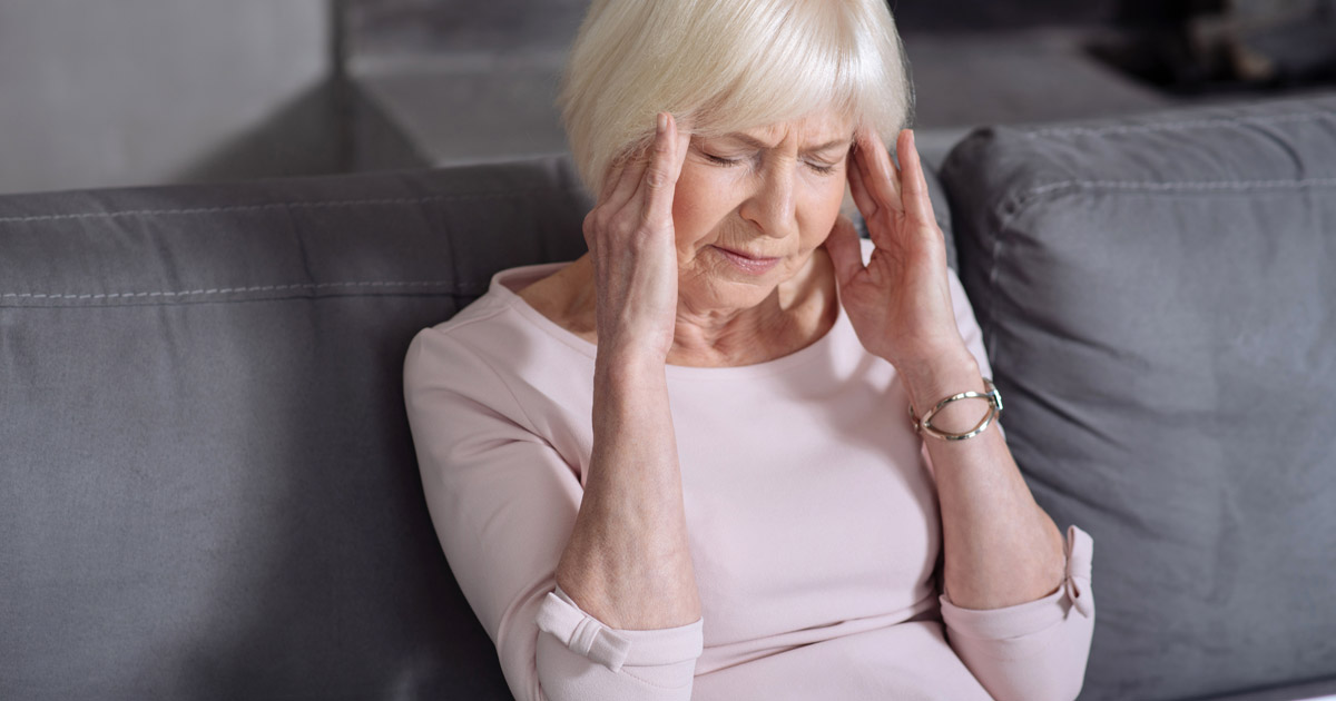 Older woman with headache