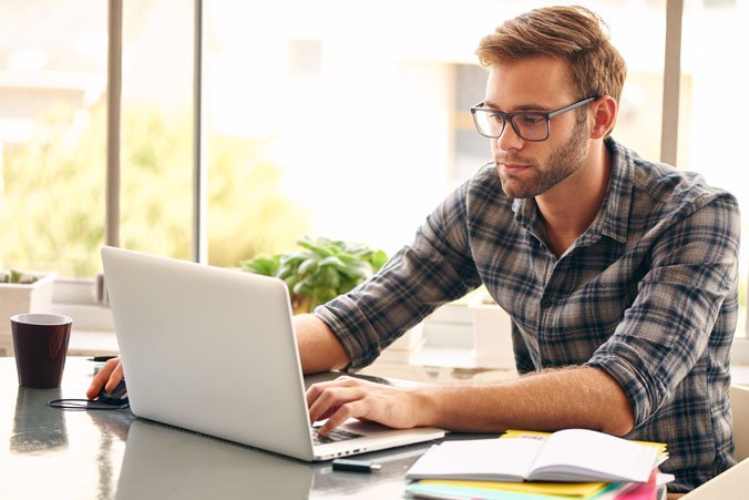 Image of man on computer