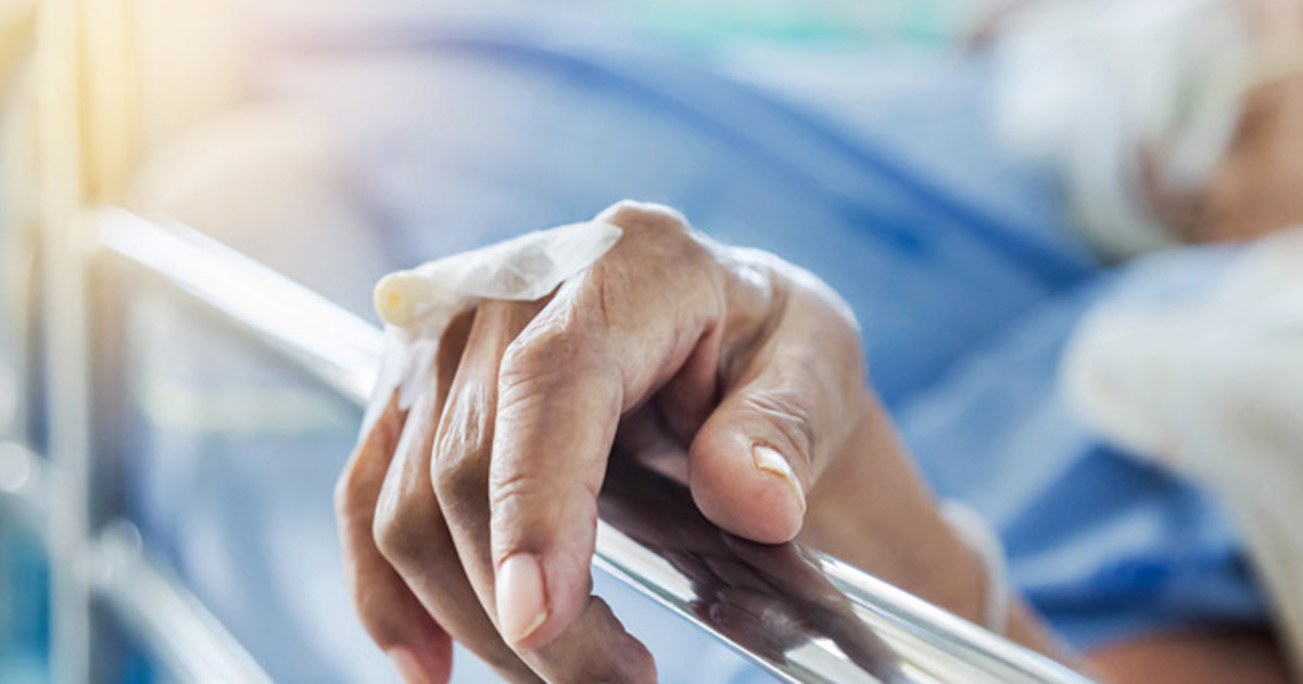 Photo of a patient in a hospital bed