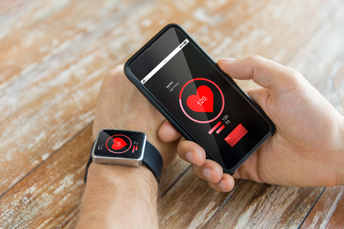 A photo of a smart watch connecting to a smart phone