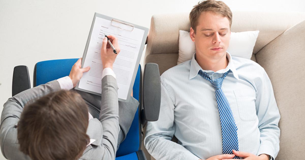 Image of man at psychiatrist (Adobe)