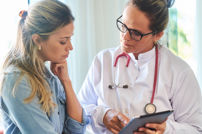 Image of doctor and female patient